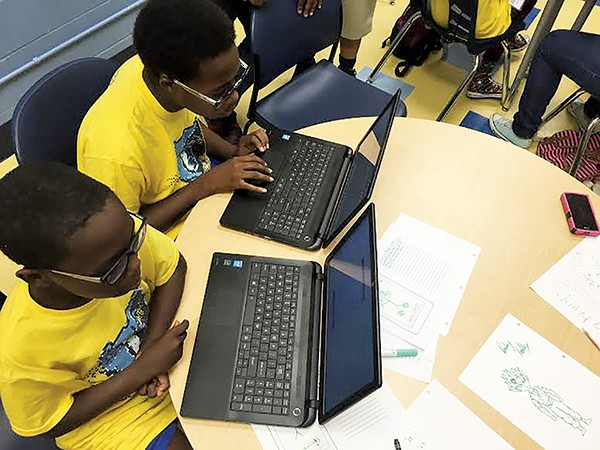 Students practice computer coding with CodeCrew. - COURTESY OF CODECREW