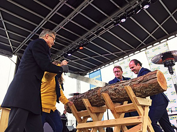 The symbolic sawing of the log at Memphis' new Ikea