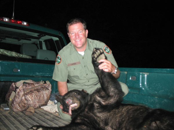 In this image from 2011, Andy Tweed holds a black bear that was found and darted at Davies Plantation. - COURTESY ANDY TWEED