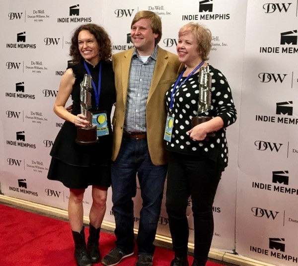 Good Grief directors Melissa Anderson Sweazy (left) and Laura Jean Hocking (right) pose on the red carpet with Indie Memphis Film Festival Executive Director Ryan Watt.
