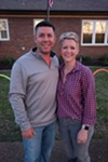 Lt. Justin McNeely of the Bartlett Fire Department and his wife, Megan, at their twilight Easter egg hunt,