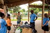 Maricela Lou-Gator welcomes Ma Ani counselor Deen Bowden and campers.