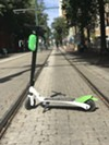 A Lime scooter on Main Street.