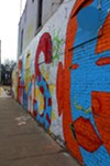 UAC's piece 'rise' painted at Humes Preparatory Academy