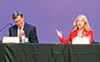Paul Rose (left) and Heidi Shafer speak at a debate in Bartlett.