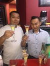 Jimmy Sinh and his brother, David Sinh, toast during the grand re-opening of Sushi Jimmi Asian fusion restaurant.