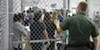 Children line up in a refugee detention center.