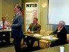 """State Senator Brian Kelsey (standing) took his turn addressing local NFIB members on Wednesday, while state Senator Mark Norris and state Representative Mark White waited their turn. At left is state NFIB director Jim Brown, who moderated the """"State Issues Roundtable."""""""