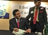 "Gonzales signing copies of memoir, ""True Faith and Allegiance,"" for Republicans at Lincoln Day"