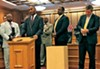 Memphis State Senator Lee Harris, at microphone, takes issue  with the GOP leadership as (l to r) state Reps. Antonio Parkinson,  G.A. Hardaway, and Joe Towns, all of Memphis, and state  Senator Jeff Yarbro of Nashville wait their turn.