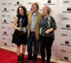 <i>Good Grief</i> directors Melissa Anderson Sweazy (left) and Laura Jean Hocking (right) pose on the red carpet with Indie Memphis Film Festival Executive Director Ryan Watt.