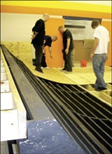 MARY CASHIOLA - Volunteers work on the half-pipe at the Greenlaw Community Center.