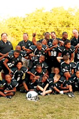 Wade West (top row, second from left) of Memphis Gridiron Ministries and his players and coaches - JUSTIN FOX BURKS