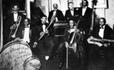W.C. Handy and his Memphis Orchestra, 1918. Handy is in rear center with moustache and cornet.