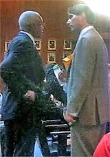 Wharton and Flinn compare notes before the Council meeting. - JACKSON BAKER