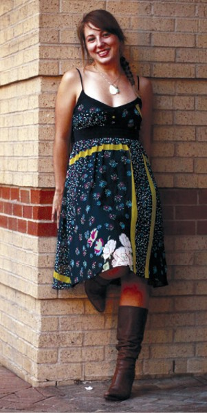 """When we spotted Frankie Manuel downtown, she looked like summer in this sundress from Forever 21 and freshly refurbished boots. - """"I got them a million years ago,"""" she says of the boots. """"They go with everything."""" - JUSTIN FOX BURKS"""