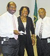 Why are these people smiling? Election commission chairman Greg Duckett, commission attorney Monice Hagler Tate, and commission director James Johnson made an effort to put the best face on election snafus at a meeting last week.