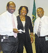 JACKSON BAKER - Why are these people smiling? Election commission chairman Greg Duckett, commission attorney Monice Hagler Tate, and commission director James Johnson made an effort to put the best face on election snafus at a meeting last week.