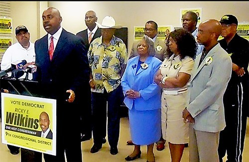 Wilkins with supporters at Thursday's press conference