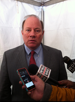 Detroit Mayor Mike Duggan talking with reporters after a press conference on Jan. 13, 2015 announcing the redevelopment of the Strathmore Hotel in Detroit's Midtown district. - RYAN FELTON/METRO TIMES