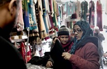 PHOTO BY KENNY CORBIN. - A 15-year-old girl buys her first abaya at Caniff Gift & Variety.