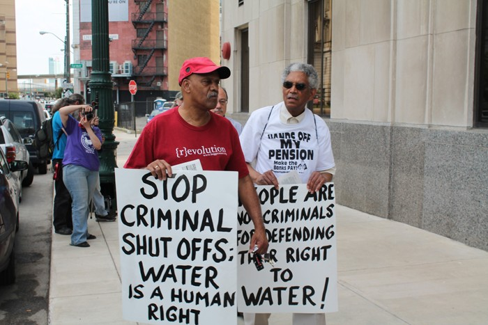 A coalition of groups rally outside of the Detroit Water & Sewerage Department's main office at 735 W. Randolph in downtown Detroit on Friday, June 6. The demonstrators were protesting efforts to shut off water service to residential customers with $150 or more in outstanding debt. - PHOTO BY RYAN FELTON.