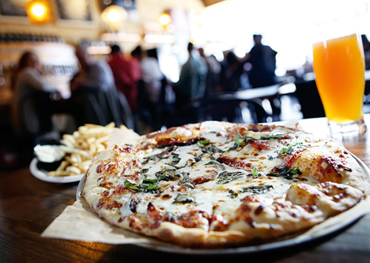 A Margherita pizza, truffle fries, and North Peak Diabolical IPA, from Jolly Pumpkin in Detroit.