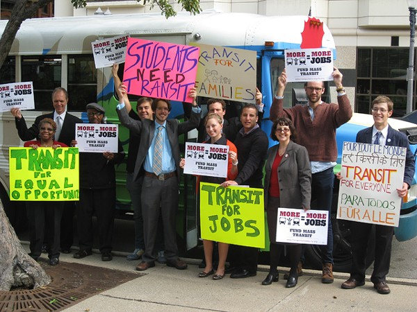 All aboard: Mass transit activists show their support in Lansing.