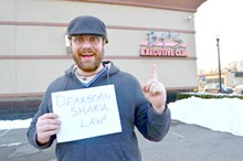"COURTESY OF BRIAN STONE. - Army Veteran Adam Joliff poses for an article by Brian Stone to demonstrate to tea party nutjobs that Dearborn is not, in fact, under ""Sharia Law."""