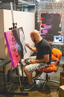 Artist Paolo Pedini at work in the Red Bull house of Art.