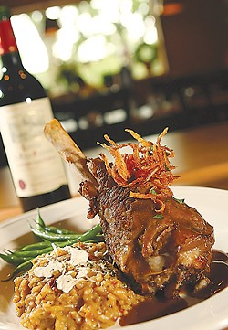 Braised Australian lamb shank with sun-dried tomato and chevre risotto. - MT PHOTO: ROB WIDDIS