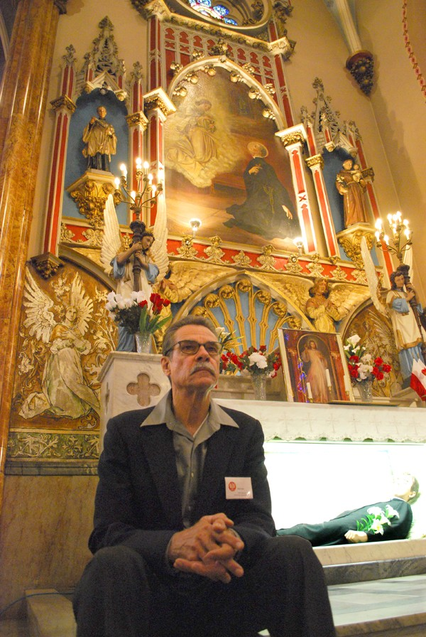 Brian Baka, guardian of the temple, sits by the mannequin of St. Stanislaus' corpse. - DETROITBLOGGER JOHN