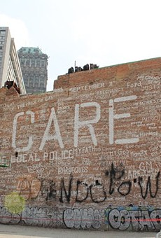 The 'Care' building was demolished after a circuit court judge ruled it was a public nuisance.