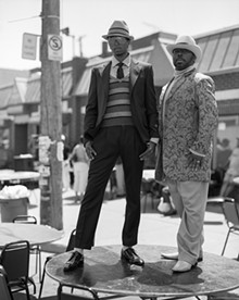 © BRUCE WEBER - Christopher Gardner, Artist, and Von Jour Reece, Fashion Designer, at Bert's Marketplace, Detroit, Michigan, 2006, gelatin silver print.