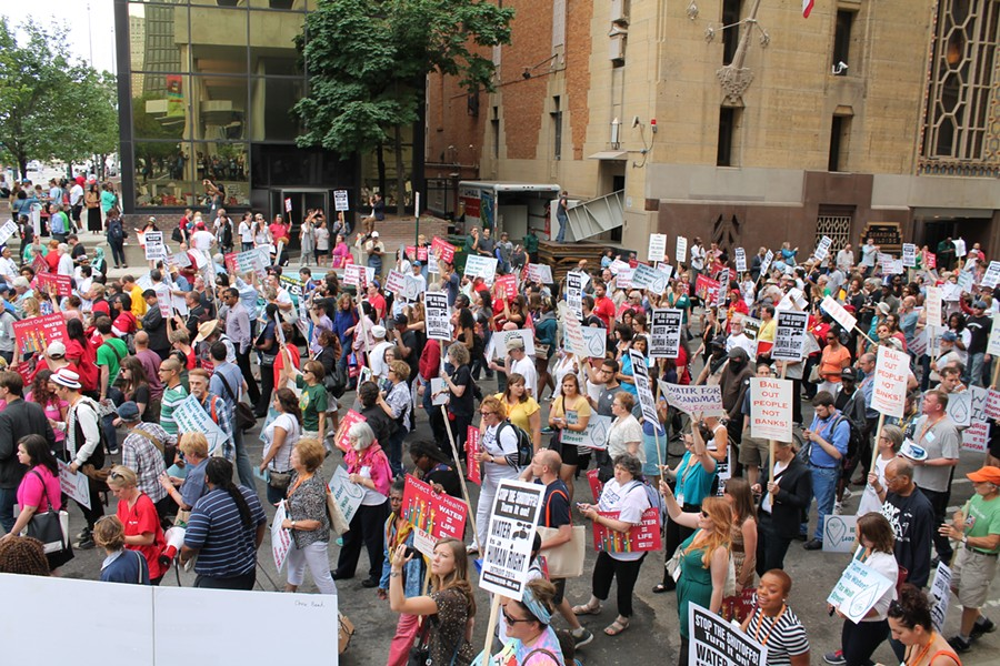 More than 1,000 people demonstrated in the streets of downtown Detroit against the city's ongoing water shutoffs on July 18, 2014. The protest was organized by the National Nurses United. - RYAN FELTON/METRO TIMES