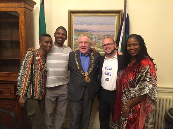 Christy Burke (center), the Lord Mayor of Dublin, with members of the Detroit Water Brigade (from left to right): Makita Taylor, DeMeeko Williams, Justin Wedes, and Shamayim Harris. - COURTESY OF THE DETROIT WATER BRIGADE