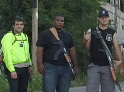 Elijah Woody (center) was arrested by Detroit police for carrying an unconcealed weapon; a rally supporting him takes place Sunday. - (FROM HELL'S SAINTS' FACEBOOK PAGE)