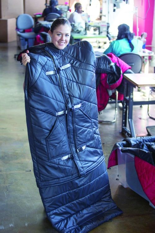 Empowerment Plan's Veronika Scott, who founded the fashion company in 2011, models her hallmark sleeping bag coat.