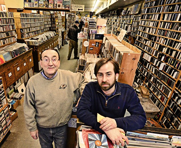 Enocore's Peter Dale with employee-musician Tadd Mullinix. - MT PHOTO: DOUG COOMBE
