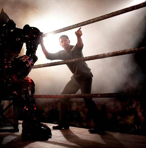Hugh Jackman points through a mess of CGI robocarnage.