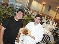 Il Gabbiano's co-owner/chefs Joe Fallea and Jonathan Rheaume serve grilled veal chop with sautéed wild mushrooms. - METRO TIMES PHOTO / LARRY KAPLAN