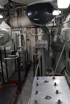 Inside the ship's hulking engine room.
