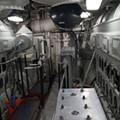 Inside the ship's hulking engine room.
