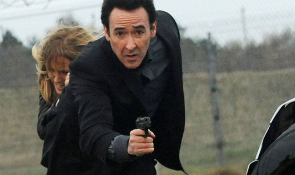 Instead of holding a boombox in the air, Cusack aims lower.