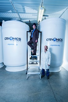 PHOTO BY DOUG COOMBE - Joe Kowalsky and Andy Zawacki with the cryogenic tanks where frozen bodies are stored.