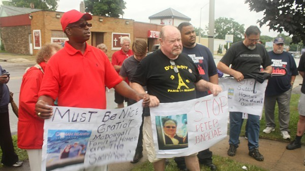 Representatives from the Detroit Eviction Defense and Detroit Residents protested outside a Singapore-based real estate firm's office in Pontiac on July 24, 2013, arguing for certain home listings to be removed. - DETROIT EVICTION DEFENSE