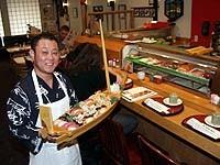 Kabuki owner K.J. Lee serves sushi for two deluxe. - METRO TIMES PHOTO / LARRY KAPLAN