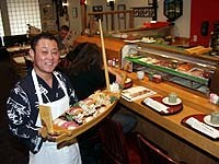 Kabuki owner K.J. Lee serves sushi for two deluxe. - METRO TIMES PHOTO / LARRY KAPLAN