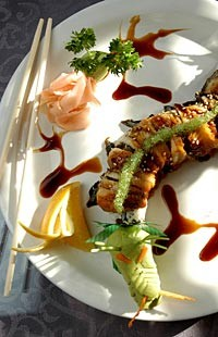 Key West roll with spicy tuna inside, BBQ eel on top and eel sauce, and wasabi tobigo shaped like a dragon from Sala Thai in Detroit. - METRO TIMES PHOTO/ ROB WIDDIS