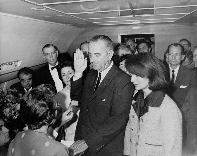 Lyndon B. Johnson takes the oath of office on Air Force One after Kennedy's assassination. Stephen King, among others, ponders where America would be without him. (Photo by Cecil W. Stoughton, White House Press Office)